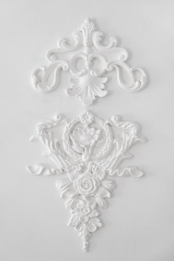 Elegant fretwork on white wall. Background royalty free stock photos