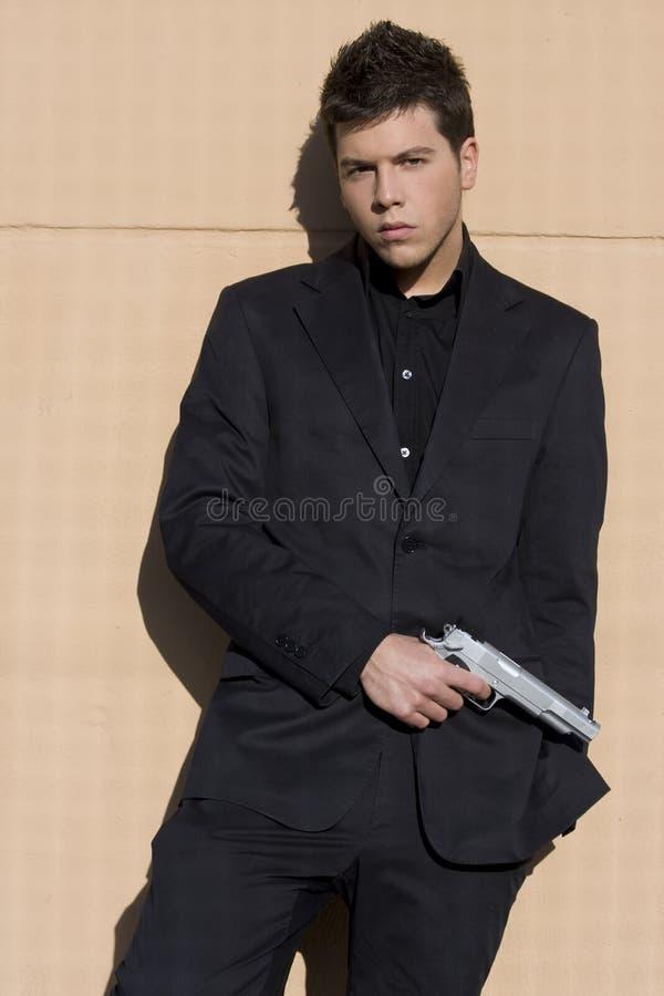 Elegant geklede bewapende mens. royalty-vrije stock afbeelding