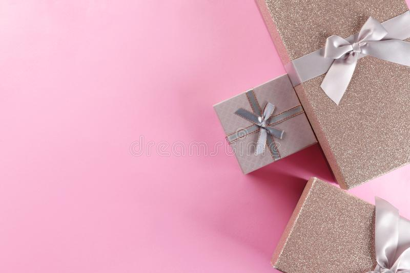 Elegant gift boxes on color background, flat lay stock images