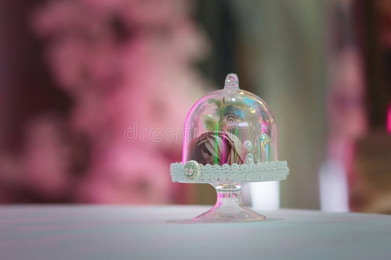 Elegant gifts made of glass with a rose stock image