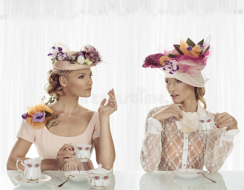 Elegant girl with cup of tea and expression royalty free stock photography