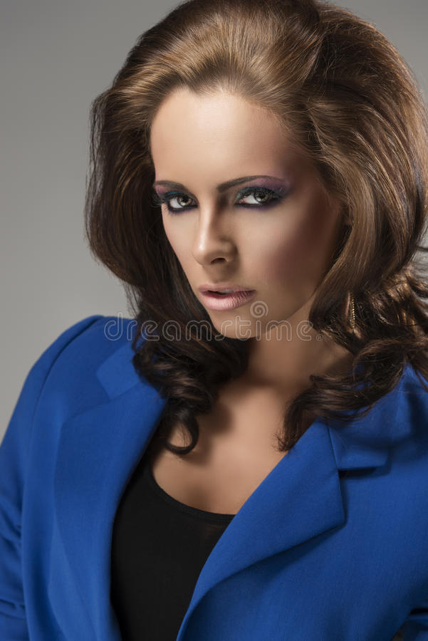 Elegant girl with fluffy hair sensual expression royalty free stock image