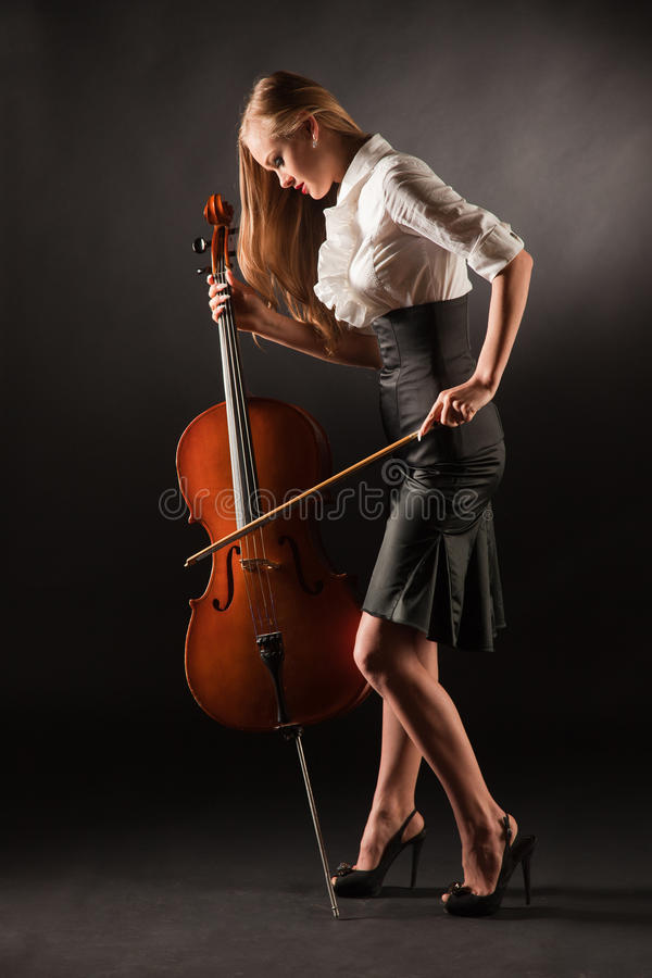 Elegant girl playing with passion on bass-viol stock photo