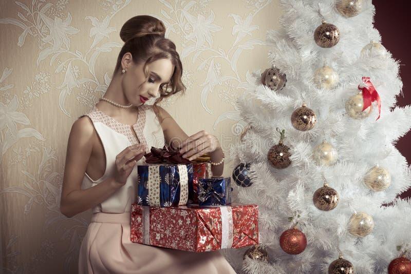 Elegant girl with xmas gifts royalty free stock photos