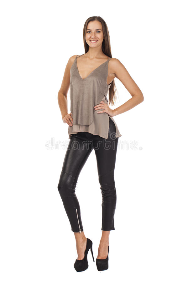 Elegant glamour woman wearing blouse and black leggins. Elegant glamour brunette woman wearing blouse and black leggins, isolated on white background stock photography