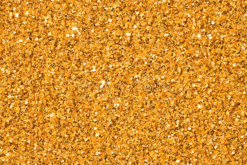 Elegant gold glitter sparkle confetti background or party invite for happy birthday, glitzy golden Christmas texture. stock photo