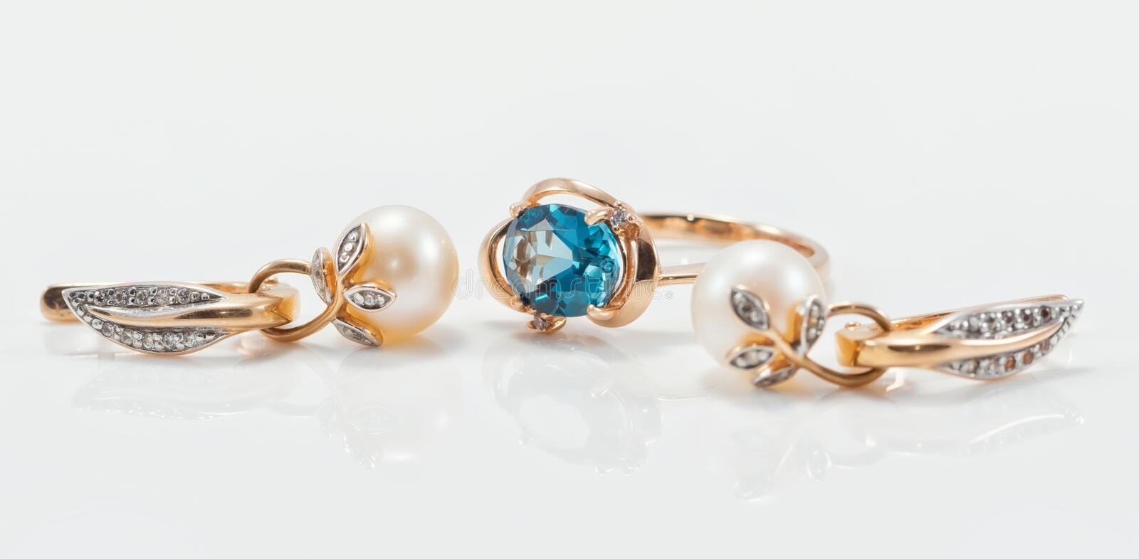 Elegant gold ring with Topaz and gold earrings with natural pear royalty free stock photos