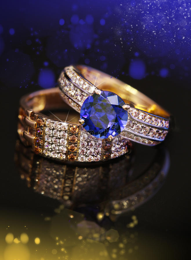Elegant golden jewelry rings with bokeh stock images