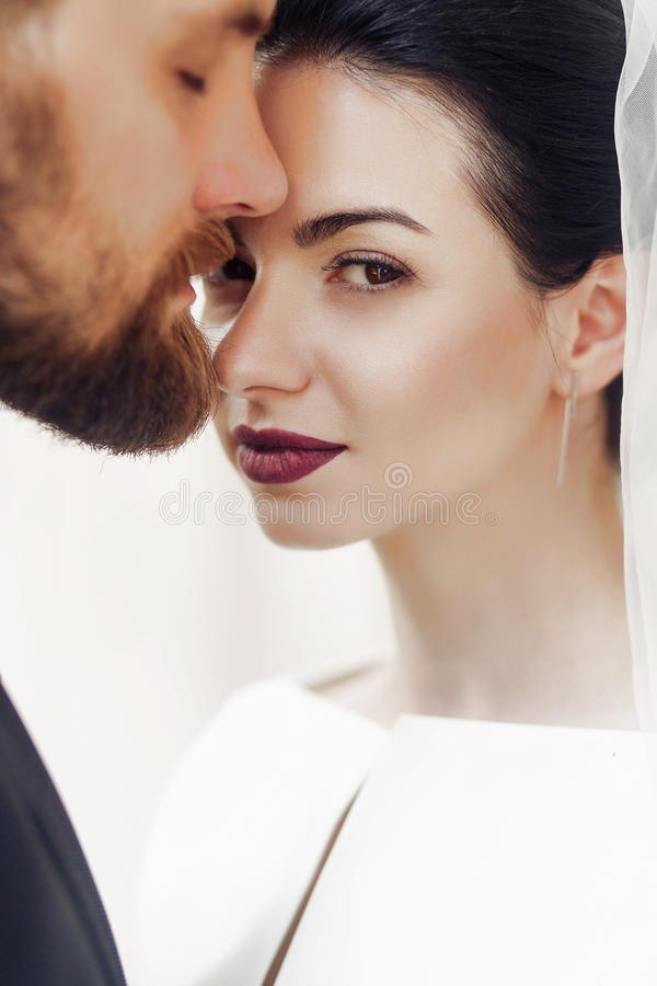 elegant gorgeous bride gently and stylish groom portraits, posing in light. unusual wedding couple in retro style. romantic moment stock photography