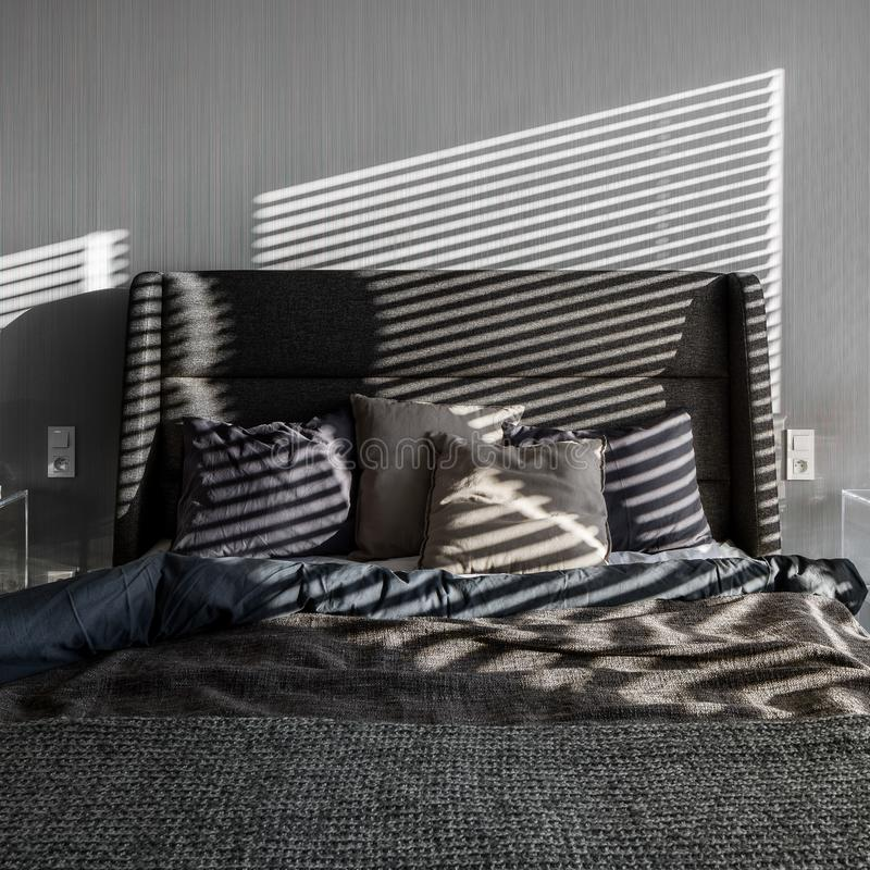 Elegant gray bedroom with wallpaper royalty free stock image