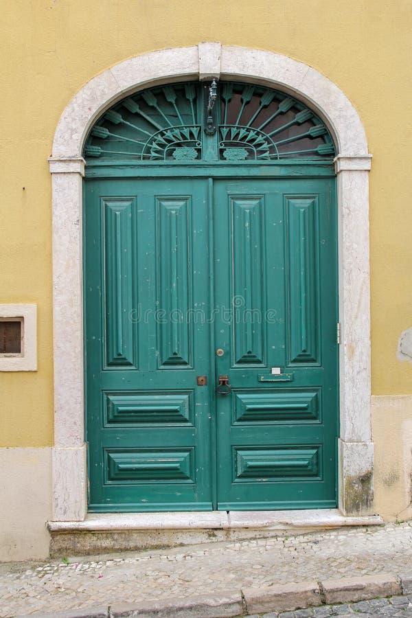 Elegant green wooden door stock image