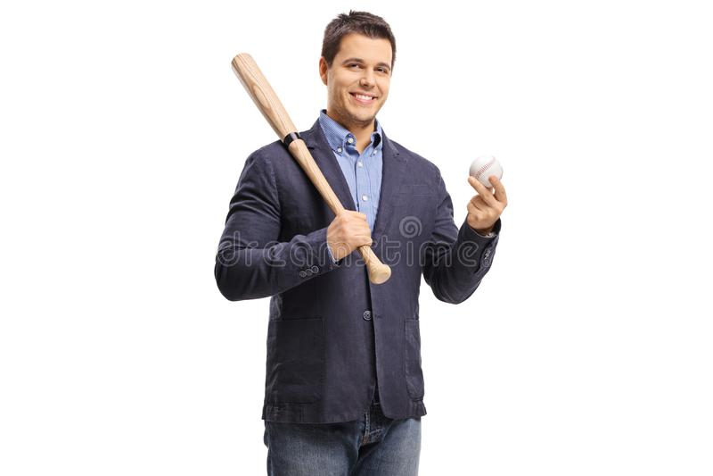 Elegant guy holding a baseball bat and a ball stock photography