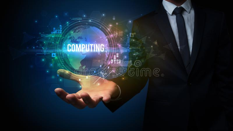 Elegant hand holding technology-related inscription. Elegant hand holding COMPUTING inscription, digital technology concept royalty free stock photos