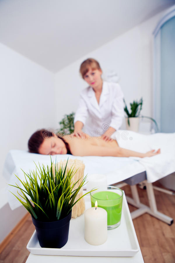 Elegant hands make a relaxing massage in spa salon young girl.  stock photos
