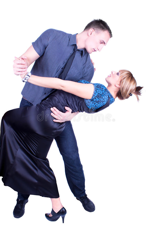 Elegant and happy romantic dancing couple royalty free stock images