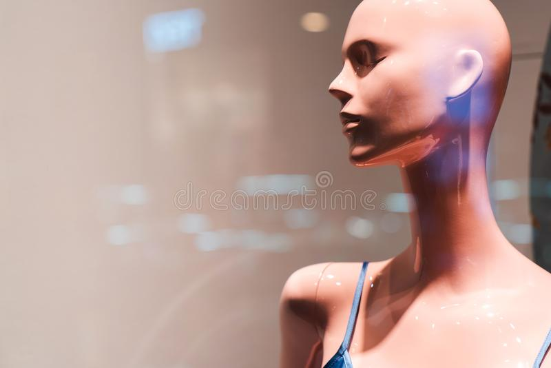 Elegant head of a female pink mannequin in the shop window without accessories royalty free stock images
