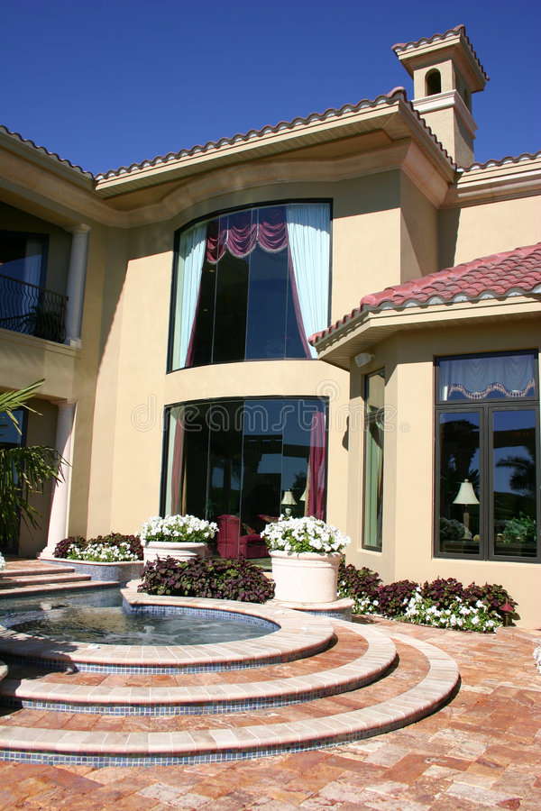 Elegant Home. Luxurious home with expansive windows overlooking beautiful patio