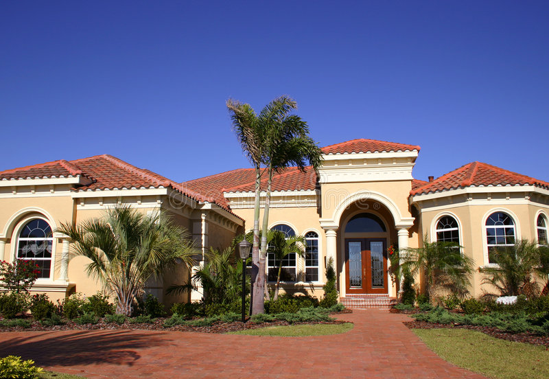 Elegant Home. In tropics with luxurious landscaping stock photography