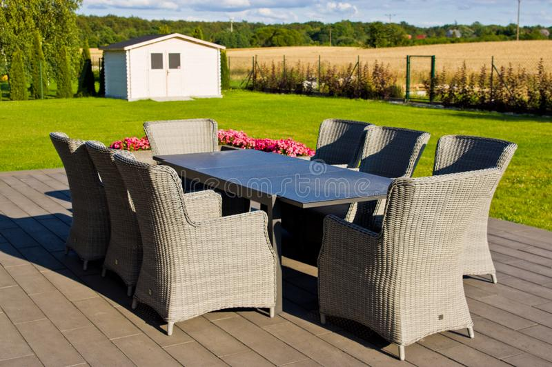 Elegant home terrace with garden furniture stock photo