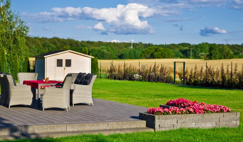 Elegant home terrace with garden furniture royalty free stock photography