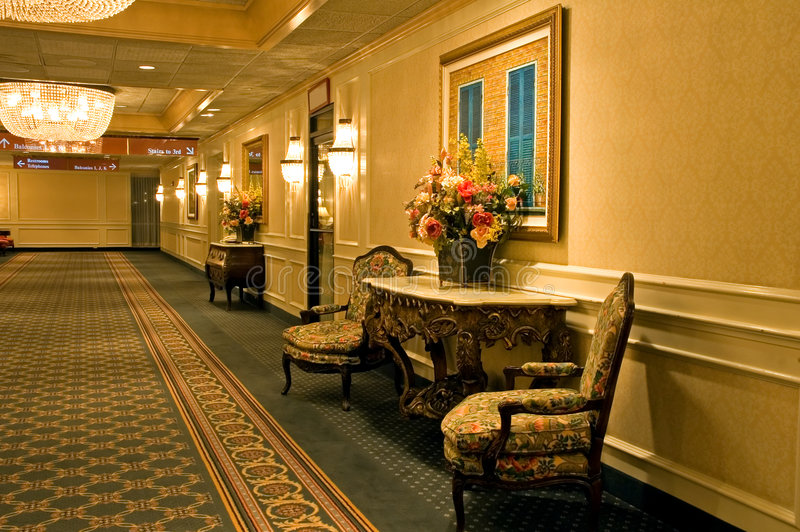Elegant hotel hallway. A view of a nicely decorated and furnished interior hallway in an exclusive hotel royalty free stock image