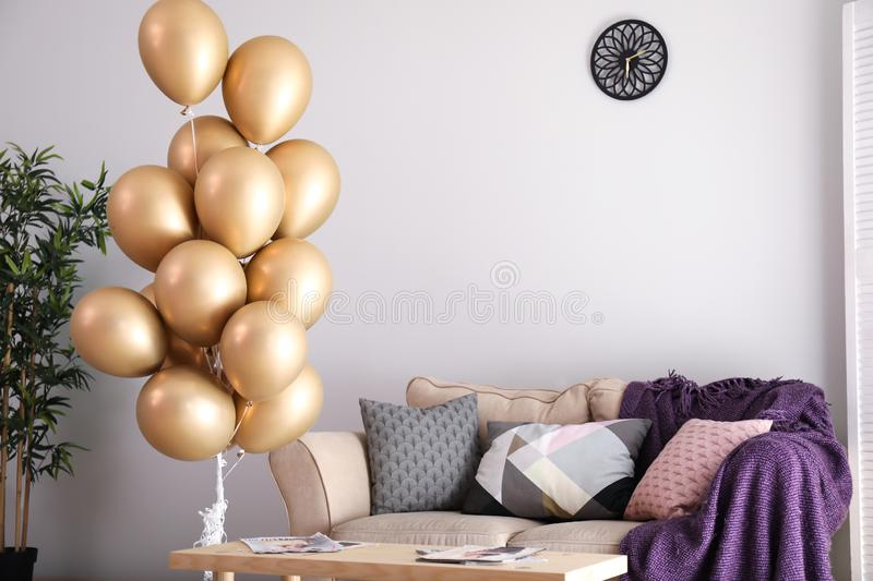 Elegant interior of living room with air balloons royalty free stock photo