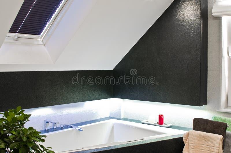 Elegant bathroom detail with corner bathtub and blue led lighting royalty free stock photos