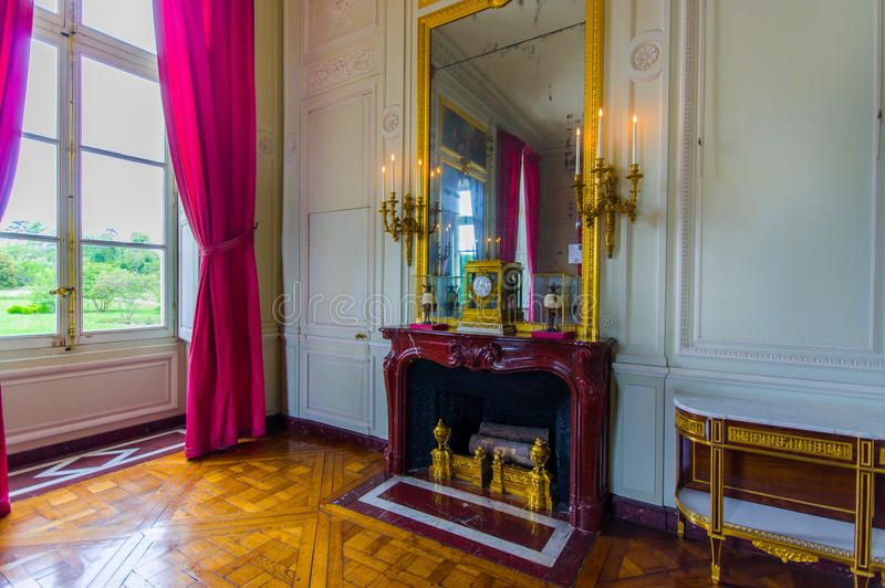 Elegant interiors in Le Petit Trianon palace. PARIS, FRANCE - JUNE 1, 2015: Elegant interiors in Le Petit Trianon palace in Versailles stock image