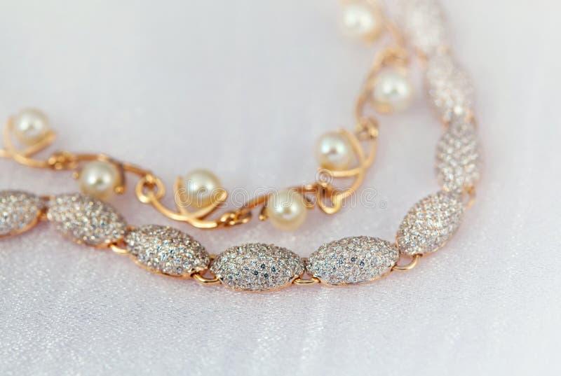 Elegant jewelry. Braceletes with jewel stone pearl and brilliants stock photos