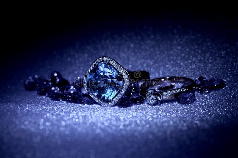 Elegant jewelry. Ring with jewel stone in night light stock photo