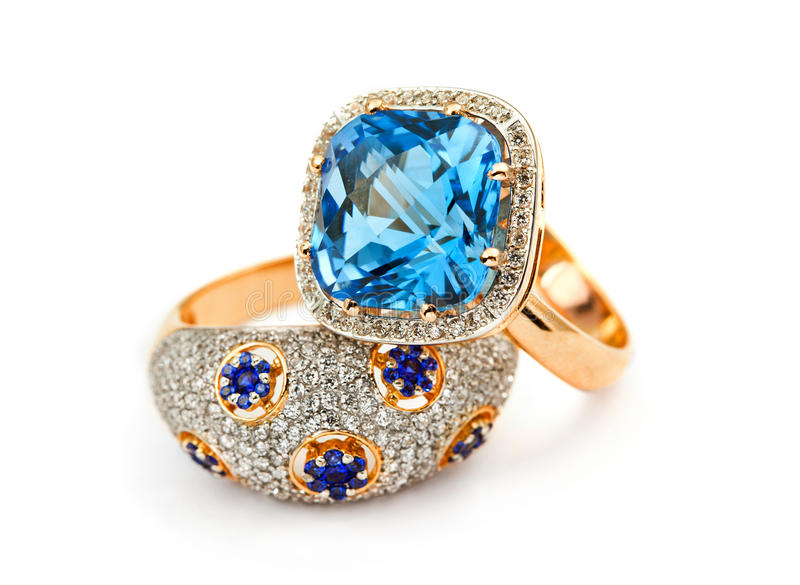 Elegant jewelry ring with sapphires and diamonds. Elegant jewelry rings with jewel stone - sapphire and blue topaz and brilliants stock photo