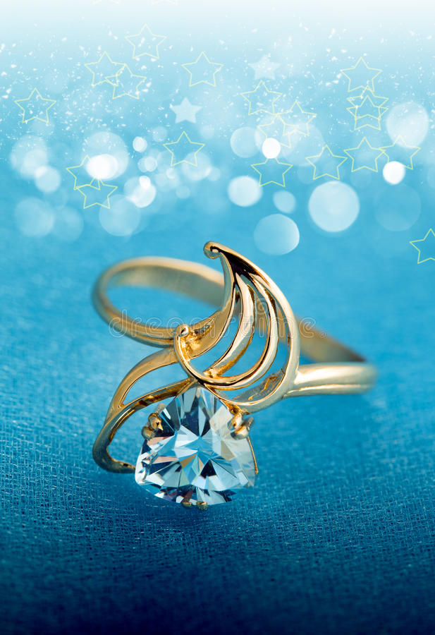 Elegant jewelry ring with blue topaz royalty free stock photography