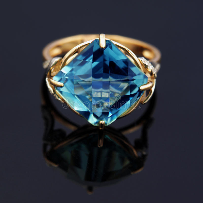 Elegant jewelry ring with blue topaz stock images