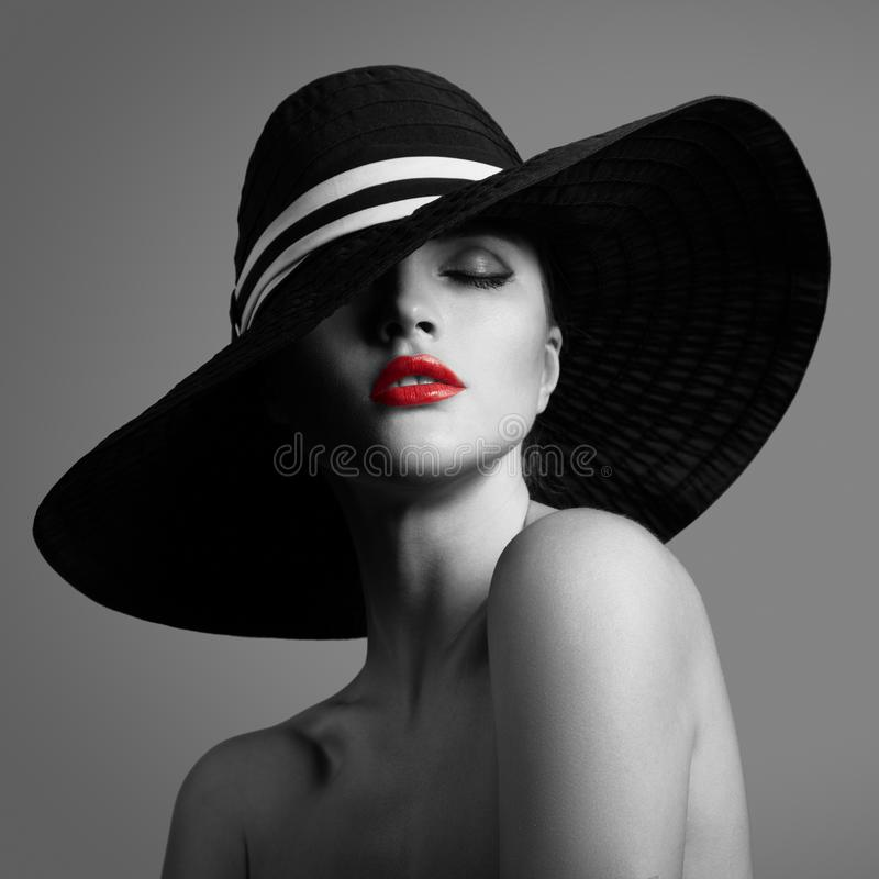 Elegant lady in hat. Black and white fashion portrait. royalty free stock photography