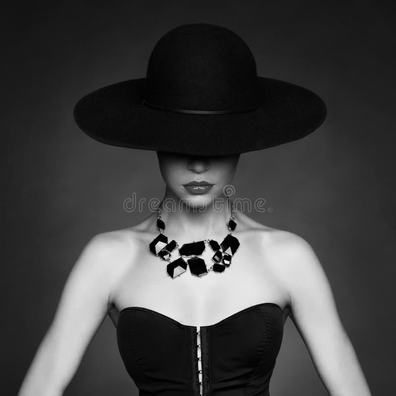Elegant lady in hat stock image