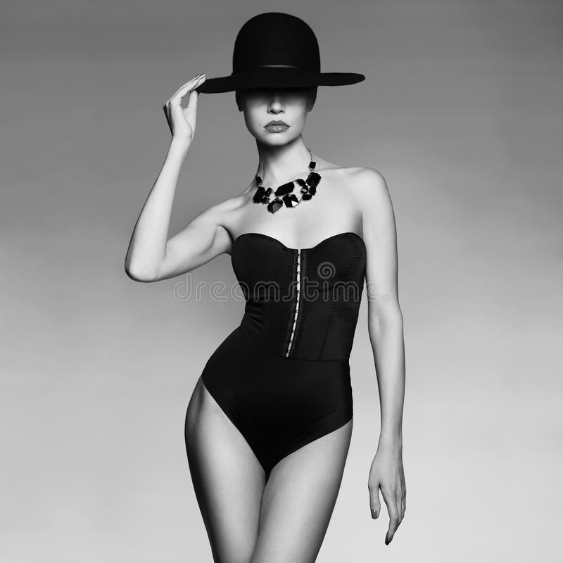 Elegant lady in hat royalty free stock image