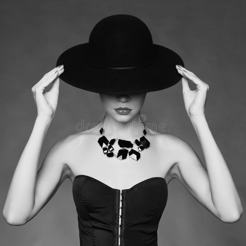 Elegant lady in hat royalty free stock photo