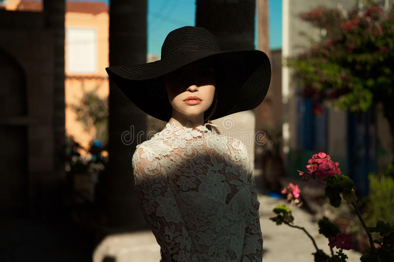 Elegant lady in an old European town royalty free stock photos