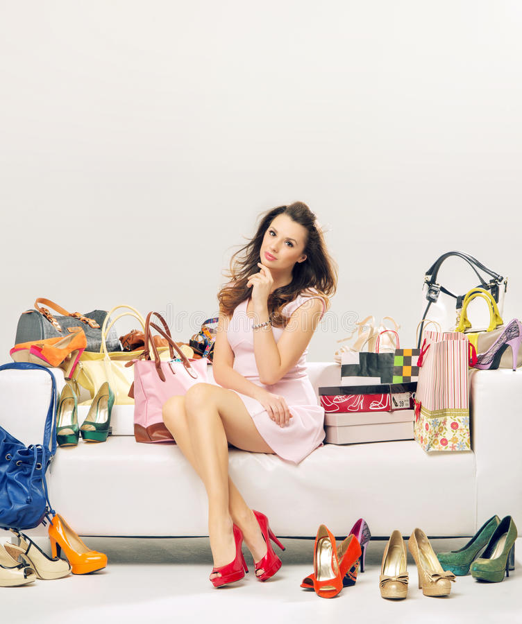 Elegant lady in a place full of fashion accessories. Elegant woman in a place full of fashion accessories stock photo