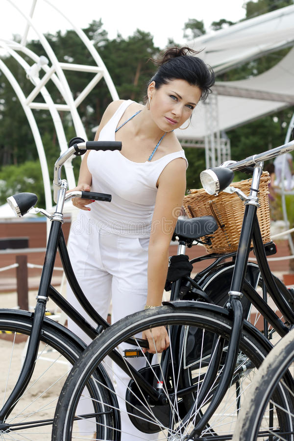 Download An Elegant Lady Travels On Bicycle Stock Image - Image: 25766065
