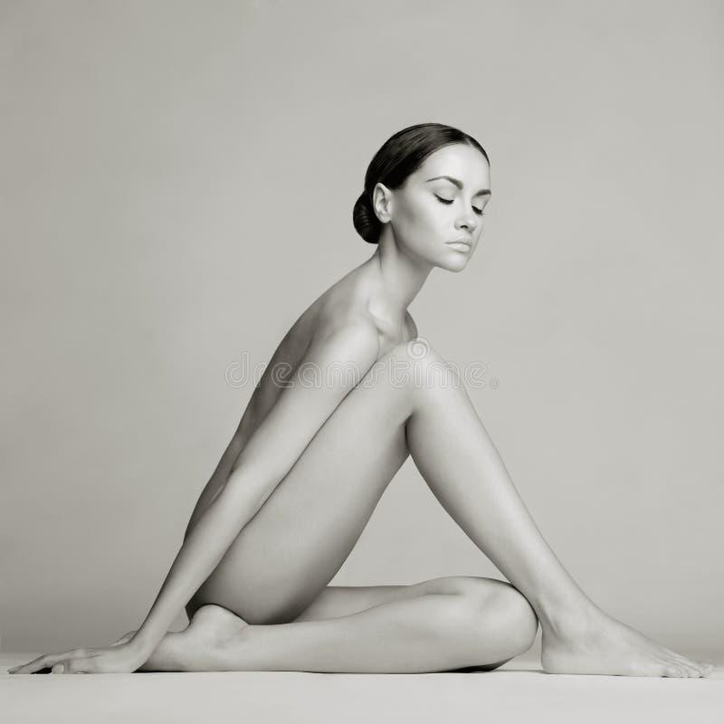 elegant ladysitting fotografering för bildbyråer