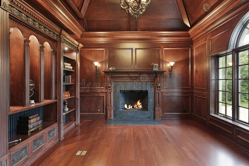 Elegant library with black fireplace royalty free stock images