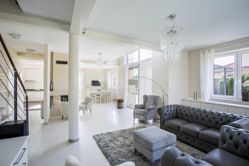 Elegant living room in a bright apartment stock images