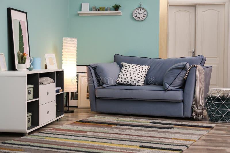 Elegant living room interior with sofa stock image