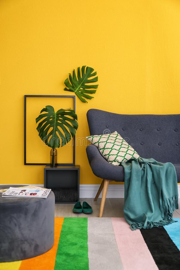 Elegant living room interior with comfortable sofa. Home design in rainbow colors stock photos