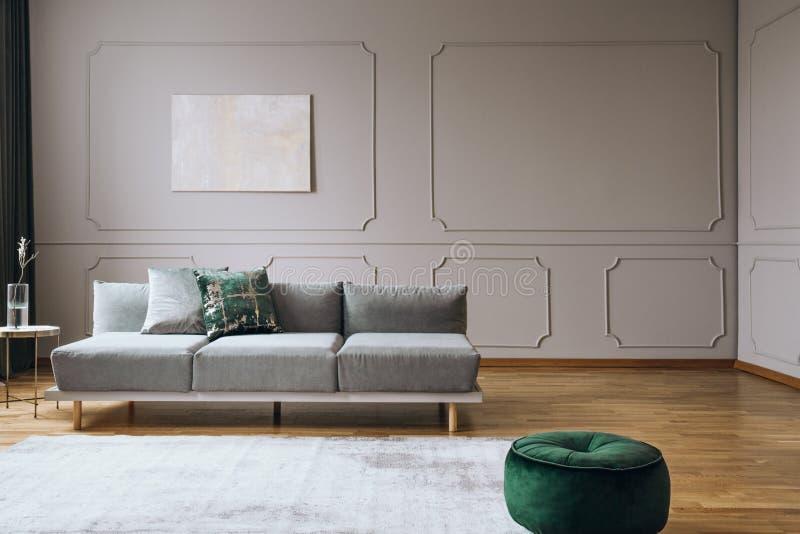Elegant living room interior with comfortable sofa, real photo stock photos