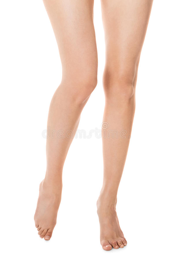 Elegant long bare female legs royalty free stock image