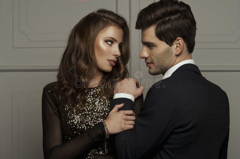 Elegant lovely couple. Elegant lovely young sensual couple stock photography