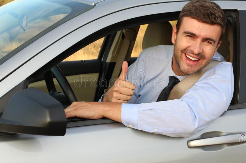 Elegant male driver giving a thumbs up royalty free stock images