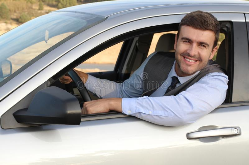 Elegant male driver with a gorgeous smile.  stock image
